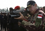 Indonesia President Susilo Bambang Yudhuyono takes aim. Will there be a coup to keep his party in power? Photo courtesy of the Presidential Office.