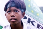 A young supporter of Indonesia's National Awakening Party (PKB). Photo by AFP.