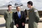Australian Prime Minister Tony Abbott with two RAAF squadron leaders at the announcement of the purchase of 58 new F35 joint strike fighters. Photo by Department of Defence.