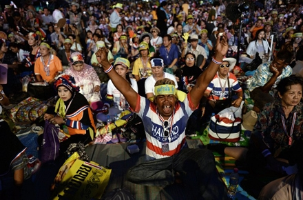 Anti-government protestors celebrate the announcement of Thailand's coup. Photo by AFP.